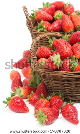 fresh strawberries in baskets  isolated on white