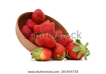 fresh strawberries in bowl on white background  - stock photo