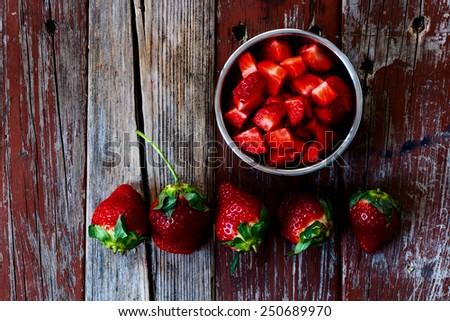 Fresh strawberries in bowl on Wooden Background. Summer or Spring Organic Berry over Wood. Agriculture, Gardening, Harvest Concept. Top view. - stock photo