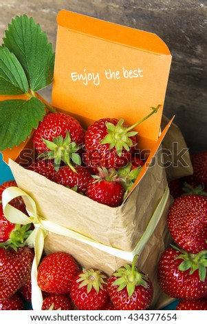 fresh strawberries in gift box with space for text (message, invitation, offer). Food Frame Background. creative thinking and original ads. soft selective focus Photo