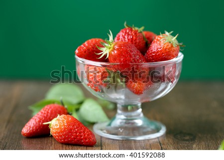 Fresh strawberries in high - foot glass