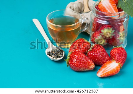 fresh strawberries on a bright background. Fruit tea with strawberries on a wooden spoon.  Food Frame Background with space for advertising text. soft selective focus Photo