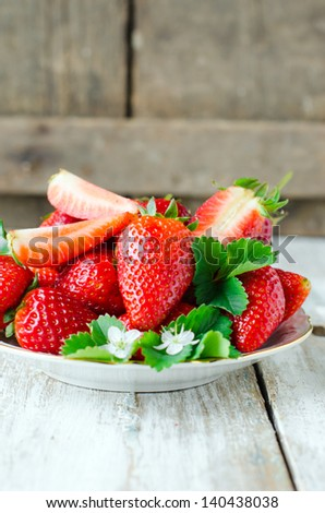 Fresh strawberries on a plate - stock photo