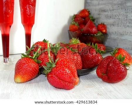 fresh strawberries on a plate and juice in the cup - fruit diet - stock photo