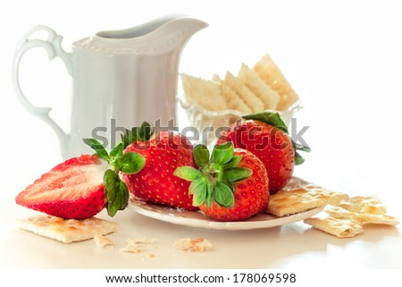 fresh strawberries on a plate with cookies and cream - stock photo
