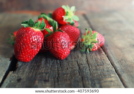 fresh strawberries on a wooden background - stock photo