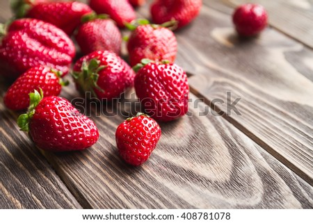 Fresh strawberries on a wooden background, selective focus - stock photo