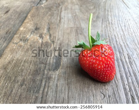 Fresh strawberries on old wooden background - stock photo