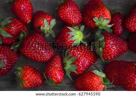 fresh strawberries on old wooden background.