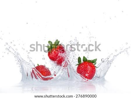 Fresh Strawberries with water splash over white background - stock photo