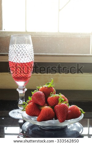 Fresh Strawberry and juice in the glassware - stock photo