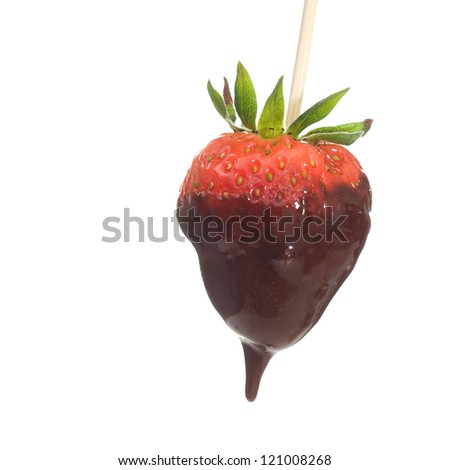 Fresh strawberry covered in dark chocolate over white background.