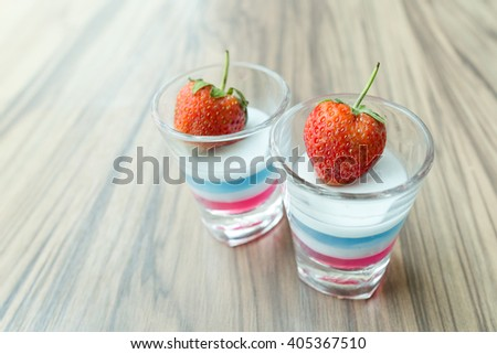 fresh strawberry decoration on jelly in shot glass - stock photo