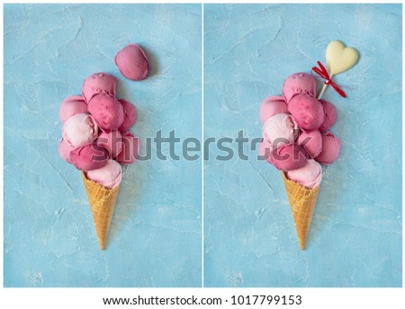 Fresh strawberry ice cream in waffle cone on blue background with copy space.