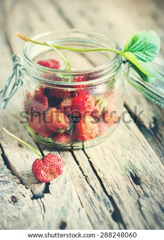 Fresh Strawberry in a Tin on Wooden Background. Toned image - stock photo