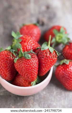 fresh strawberry in small bowl  - stock photo