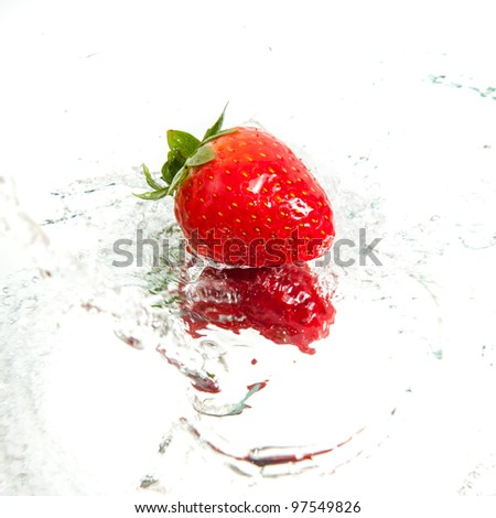 Fresh strawberry in water splash
