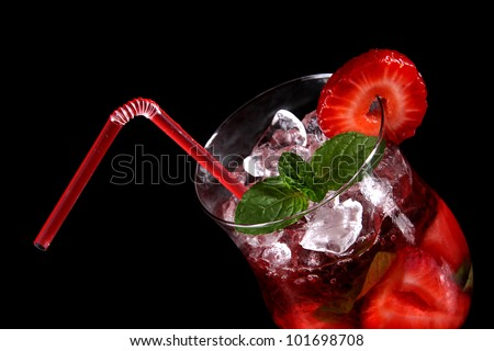 Fresh strawberry mojito drink over black - stock photo