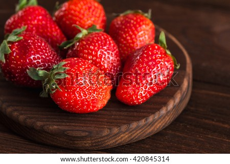 Fresh strawberry on cutting board. Ripe strawberry closeup - stock photo