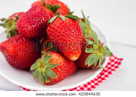Fresh strawberry on the plate. Ripe strawberry closeup - stock photo
