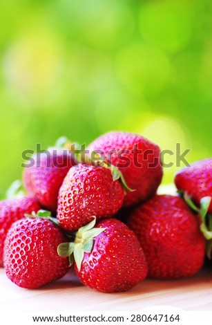 Fresh strawberrys in natural green background - stock photo