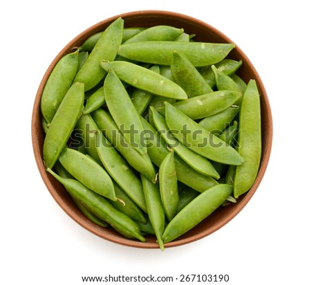 fresh sugar snap peas in bowl isolated on white  - stock photo