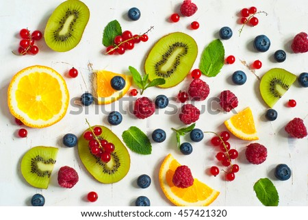Fresh summer berries and fruits on white  background. Healthy food concept. Flat lay. Fruit background.