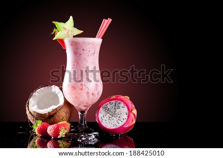 Fresh summer cocktail with exotic fruit, isolated on black background - stock photo