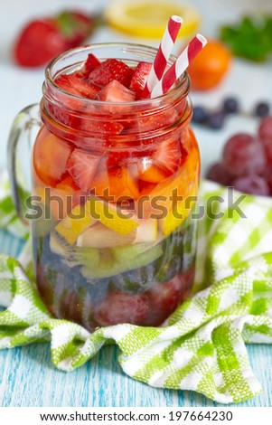 Fresh Summer Rainbow Sangria with Colorful Fruits And Berries - stock photo