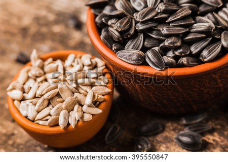 Fresh Sunflower seed and oil. Shelled sunflower seeds in wood bowl. 