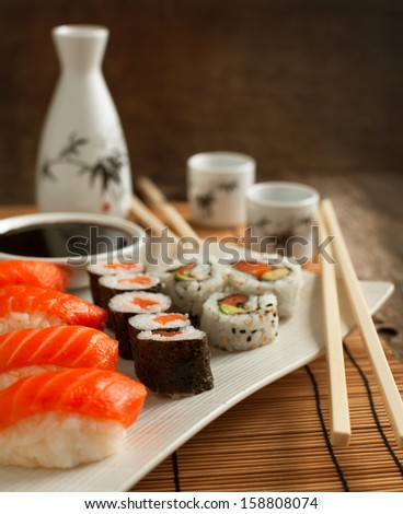 Fresh sushi and rolls on the plate - stock photo