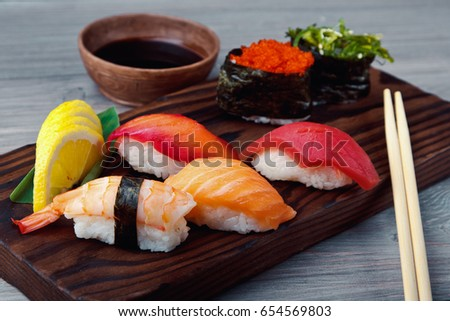 Fresh Sushi set with salmon, prawns and tuna. Traditional Japanese cuisine.