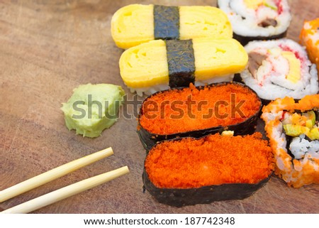 fresh sushi traditional japanese food on wood background