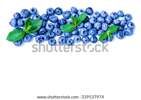 Fresh sweet blueberry fruit and leaf of mint. Dessert healthy food. Group of ripe blue juicy organic berries. Raw summer diet. Delicious nature vegetarian ingredient. Isolated on white background. - stock photo
