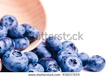 Fresh sweet blueberry fruit. Dessert healthy food. Group of ripe blue juicy organic berries. Raw summer diet. Delicious nature vegetarian ingredient. Isolated on white background. - stock photo