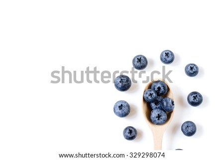 Fresh sweet blueberry fruit in spoon. Dessert healthy food. Group of ripe blue juicy organic berries. Raw summer diet. Delicious nature vegetarian ingredient.  - stock photo