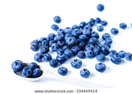 Fresh sweet blueberry fruit in spoon. Dessert healthy food. Group of ripe blue juicy organic berries. Raw summer diet. Delicious nature vegetarian ingredient on white background - stock photo