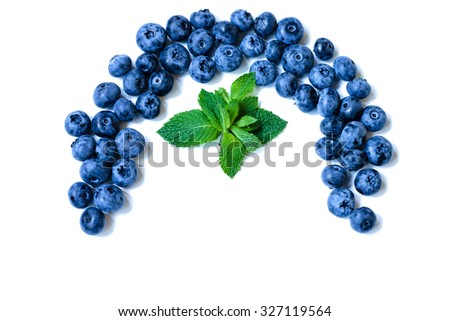 Fresh sweet blueberry fruit in the wooden spoon, juicy blueberry with leaf of mint. Dessert of juicy blueberry healthy food Group of ripe blue blueberry juicy organic berries Delicious juicy blueberry - stock photo