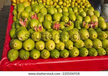 fresh sweet guava fruits group in street market New Delhi , India - stock photo