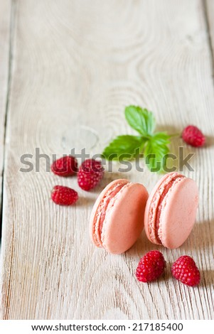 Fresh sweet macarons with berries. Food background with copy space. - stock photo