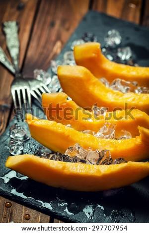 Fresh sweet melon with ice - stock photo