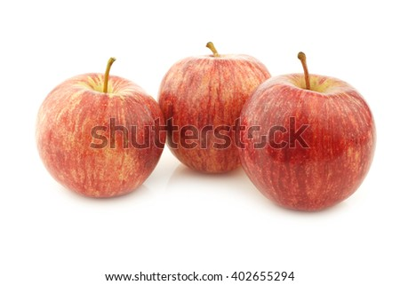 fresh sweet small apples on a white background - stock photo