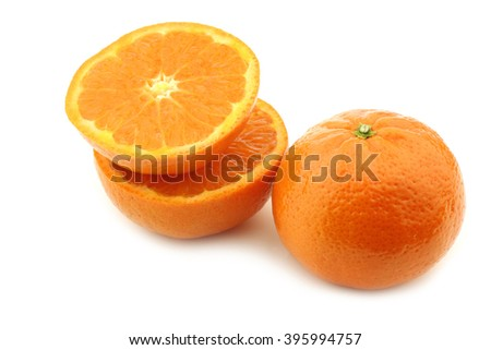 fresh tangerine and a cut one on a white background
