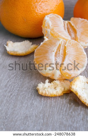 fresh tangerines in a wooden box - stock photo