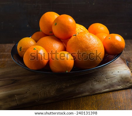 fresh tangerines on plate - stock photo