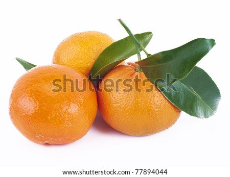 Fresh tangerines with green leafs isolated on white background