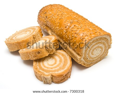 Fresh tasty bread which is cut on a part. Isolation on white. Shallow DOF.