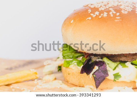 fresh tasty burger and french fries isolated on white