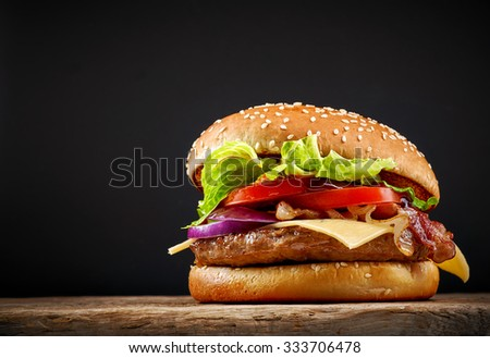 fresh tasty burger on wooden table