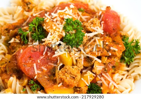 Fresh & Tasty can't be beat! Pasta Fusilli & Bolognese style meat sauce with added vegetables & grated Italian Parmigiano Reggiano.  - stock photo